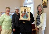 Grace, Mary Jo, and Michele flank an icon.